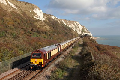 67021 tnt 67024 on the 1Y46 London Victoria to Folkestone West at Capel-le-Ferne on the 2nd November 2017  Class67, DB, DoverCoast, VSOE