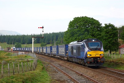 68007 on the 4H47 Mossend to Inverness departing Dalwhinnie on the 9th June 2018