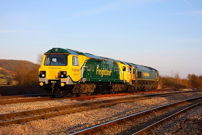 70009 hauling 66548 at Bishton on the 0Z25 Stoke Gifford to Crewe Basford Hall on the 30th January 2011