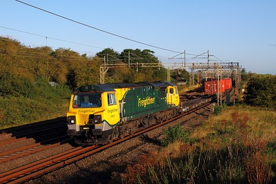 70007 on the 4L52 Garston to London Gateway at Old linslade on the 19th August 2017