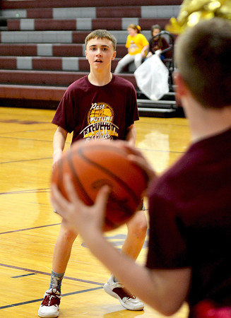 Dieterich Junior High eighth grade basketball player Noah Dill, right, inbounds the basketball to eighth grader Garrett Nieburgge, left, Saturday afternoon during the Father's and Son's basketball game. Charles Mills photo