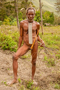 Gentleman of the Dani people in the Balem Valley, central highlands of West Papua, New Guinea, Indonesia. He's wearing the traditional koteka or penis gourd.