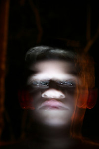 While camping with my sons Tiger Scout troop, I asked Ryan to point his flashlight up at his face while I hand held my camera.        Either he moved or I moved or both.  Still, I like the weirdness of the shot.  This is what we do when we have time to goof around.