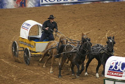 Houston Livestock and Rodeo Wagon Races.  ...Always fun to watch!  This image was taken from the stands.