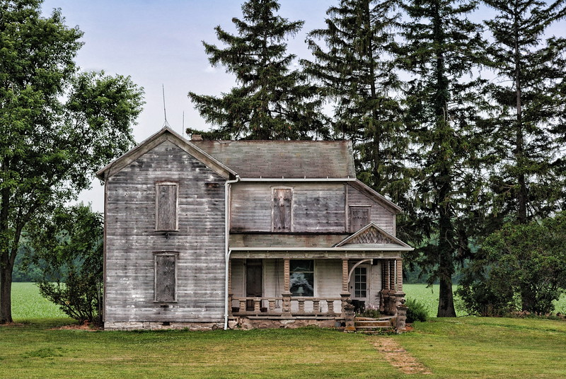 Old vacant farmhouse in northwest Ohio. I found the reflection in the front window<br /> to be very interesting .......