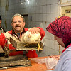 Donna Gustafson Selling a Chicken in Morrocco