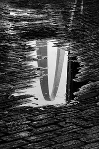 o-arch reflection in puddle 3rd Larry cameron