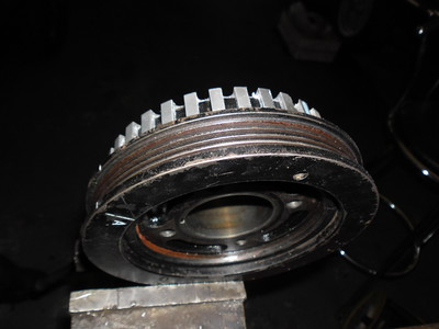 Early trigger wheel attached to the crank pulley