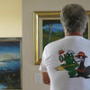 An old SEAL pretending he understands the art he's viewing.