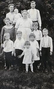 """Mother, Julie with Vera, Father Sherman Ruth, Edna, Raymond Melvin, Wayne, Marie, Byron Dorothy"""