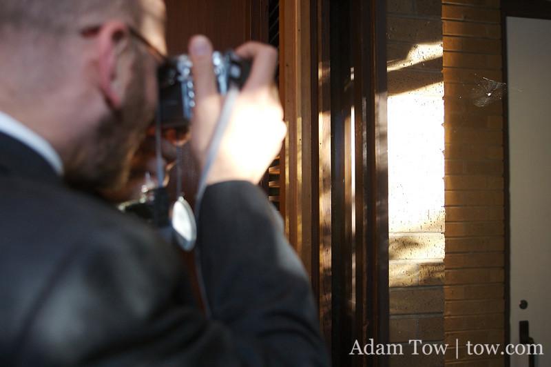 John photographs a spider crashing the reception