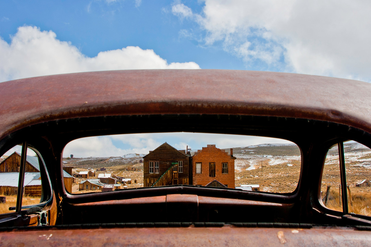 BE104  Bodie State Park, California. Exterior shots.  Through the back window of rusting car.