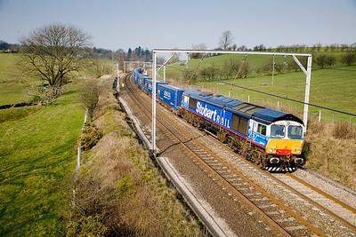 260307 66411 passes Lambrigg with the 4S43 0631 Daventry-Grangemouth tesco express