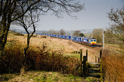 270306 66411with the 4S43  0631 Daventry-Grangemouth heads north at Beck house