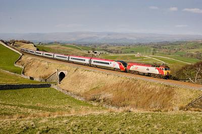 310307 57310 Drags Pendolino 390002 through Birkett common with the diverted 1M87 1310 Glasgow - Euston