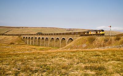 310307 60013 with the 6E16  17:34 Newbiggin-Milford crosses dandry Mire viaduct