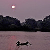 Rising sun over the Nuwera lake and the fishermen going out in their boats laying their nets.
