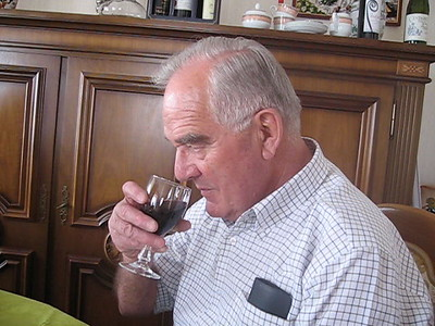 Roger Otier is testing the wine before he toasts Elli