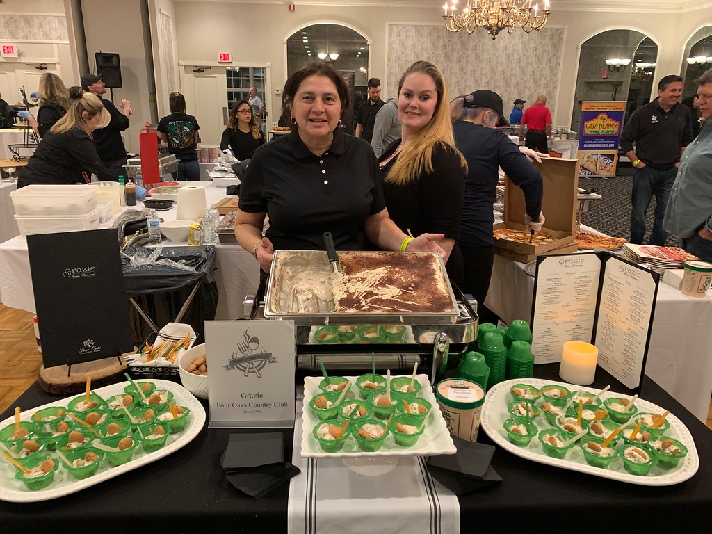 . Nancy Woods, left, and Kendra Jussaume, both of Dracut, serve tiramisu for Grazie Italian Restaurant at Four Oaks County Club in Dracut.