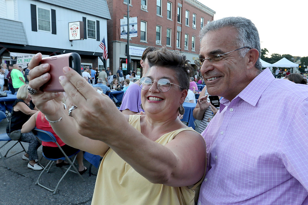 ". Leominster held its first-ever ""Dining Under The Stars!\"" event on Wednesday night. They closed down Central Street in Downtown Leominster and brought the restaurants and bars within the road closure out into the street for all to enjoy. Trea McReynolds of Leominster takes a selfie with Leominster Mayor Dean Mazzarella during the event. SENTINEL & ENTERPRISE/JOHN LOVE"