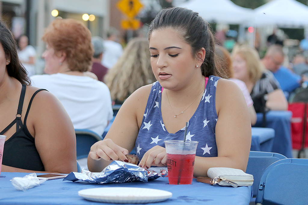 ". Leominster held its first-ever ""Dining Under The Stars!\"" event on Wednesday night. They closed down Central Street in Downtown Leominster and brought the restaurants and bars within the road closure out into the street for all to enjoy. Enjoying some food at the festival is Kristina Perera from Pepperell. SENTINEL & ENTERPRISE/JOHN LOVE"