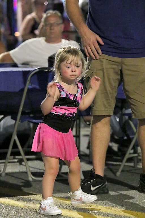 ". Leominster held its first-ever ""Dining Under The Stars!\"" event on Wednesday night. They closed down Central Street in Downtown Leominster and brought the restaurants and bars within the road closure out into the street for all to enjoy. This little girl enjoys dancing to the music of The Full Monty at the event. SENTINEL & ENTERPRISE/JOHN LOVE"