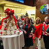 From left, Team Forever Young's Tammy Fannon, Nancy Cook and Patti Mason, all of Westford, check out a  toilet-paper tree donated by Westford Girl Scout Ambassador Troop 60560. And who isn't looking for a little TP these days?