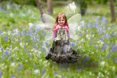 Girl behind log wings