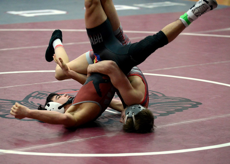 Loveland 113-pounder Cody Thompson stacks up Alec Beltran of Horizon on his way to a pin in 3:30 of their semifinal match at Saturday's Diny Pickert Invitational wrestling tournament in Berthoud. (Mike Brohard/Loveland Reporter-Herald)