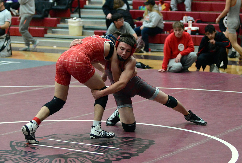 Loveland 126-pounder Isaac Lujan reaches for the leg of Glenwood Springs' Erik Krauth on his way to an 11-2 major decision in their semifinal match at Saturday's Diny Pickert Invitational wrestling tournament in Berthoud. (Mike Brohard/Loveland Reporter-Herald)