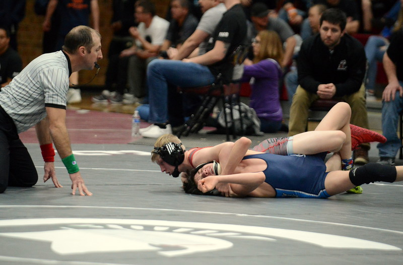 Kobi Johnson of Loveland puts Karsten Wells of Vista Peak on his back on his way to a fall in 1:46 in their 106-pound semifinal match at Saturday's Diny Pickert Invitational wrestling tournament in Berthoud. (Mike Brohard/Loveland Reporter-Herald)