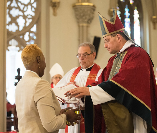 Garden City, NY: April 11, 2017--  Rev. Michael Delaney assists Bishop Lawrence Provenzano as he blesses the oils at the Chrism Mass held today at the Cathedral of the Incarnation.   © Audrey C. Tiernan