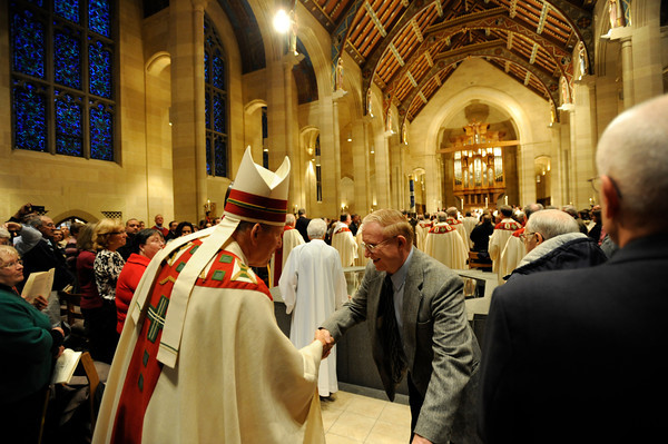 Sacred oils to be used throughout the year are blessed by Bishop Matthew H. Clark during the annual Chrism Mass at Sacred Heart Cathedral.