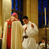 Bishop Matthew H. Clark blesses the oils during the annual Chrism Mass at Sacred Heart Cathedral.