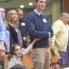 Autumn Coble holds her father hand as he take part in the Rite of Election of Catechumens on Mar 10 at St. Mary Our Mother in Hosrehead.(Courier photo by John Haeger)