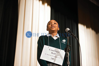 Courtney Bell of St. Mark the Evangelist Catholic School breathes a sigh of relief as she wins the annual Dallas diocesan spelling bee Jan. 12 at Cistercian Preparatory School in Irving.