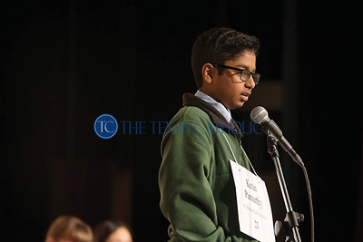 Ketan Pamurthy of St. Monica Catholic School spells a word during the annual Dallas diocesan spelling bee Jan. 12 at Cistercian Preparatory School in Irving.