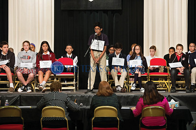 Brian Georgel of Mary Immaculate Catholic School in Farmers Branch stands in front of the judges during an earl round at the annual Dallas diocesan spelling bee Jan. 12 at Cistercian Preparatory School in Irving.