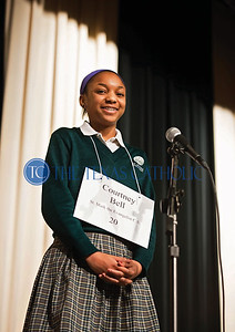 Courtney Bell of St. Mark the Evangelist Catholic School wins the annual Dallas diocesan spelling bee Jan. 12 at Cistercian Preparatory School in Irving.