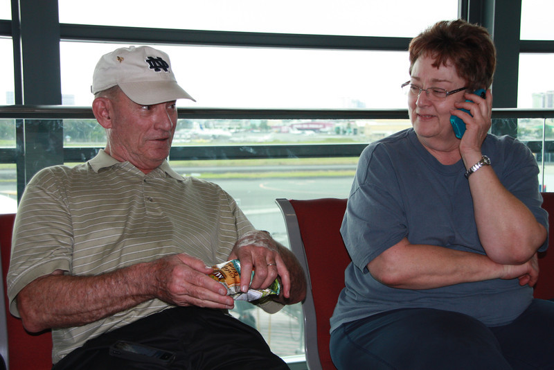 Bill and Pam Hill discuss Iphones and almonds in the airport in Manila, waiting for the flight to Bacolod.