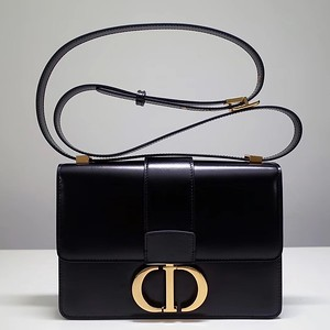 30 Montaigne flap bag in smooth black calfskin and CD clasp  Reference  M9203UMOS_M911