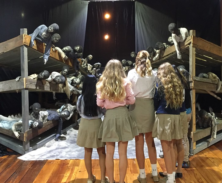 Eighth graders from a local academy take in the Diorama following a private showing for their class.