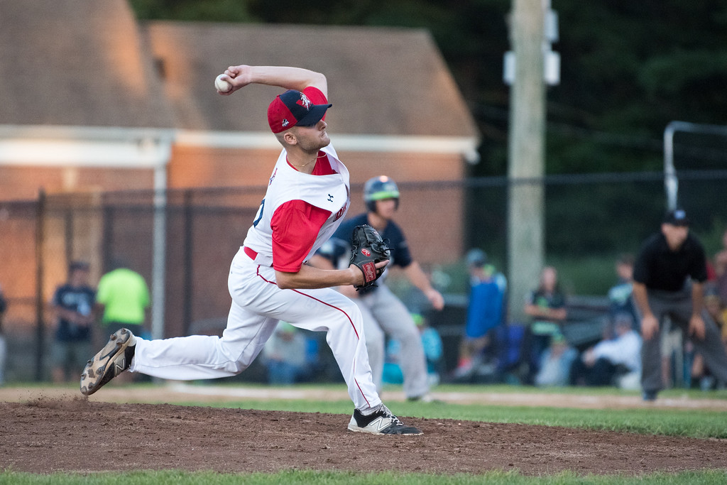 . Dirt Dawgs third pitcher to enter the game, Nick Dombkowski, delivers the pitch with a runner on first during game 1 of the Futures League playoffs where the Wachusett Dirt Dawgs face off against the Worcester Bravehearts on Tuesday Aug. 8, 2017 at Doyle Field in Leominster.  SENTINEL & ENTERPRISE/ JEFF PORTER