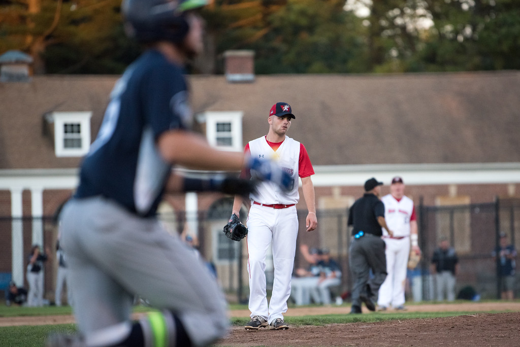 . Dirt Dawgs third pitcher to enter the game, Nick Drombkowski, watches the runner approach home after a home run at the top of the 4th inning during game 1 of the Futures League playoffs where the Wachusett Dirt Dawgs face off against the Worcester Bravehearts on Tuesday Aug. 8, 2017 at Doyle Field in Leominster.  SENTINEL & ENTERPRISE/ JEFF PORTER