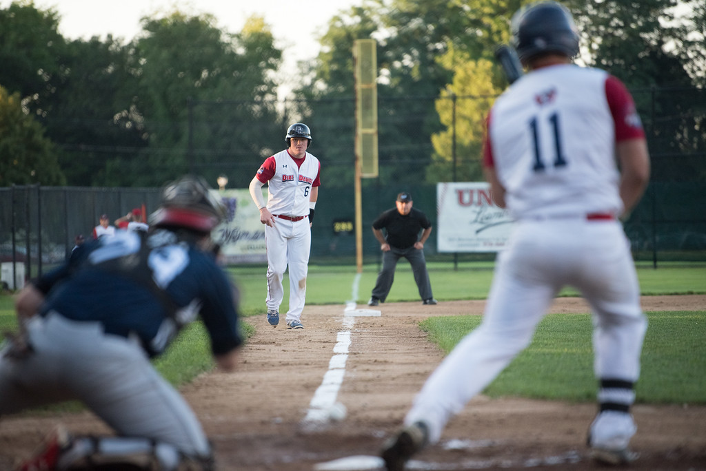 . Dirt Dawgs baserunner Zack Tower leads up the third base line as Bravehearts catcher drops the pitch during game 1 of the Futures League playoffs where the Wachusett Dirt Dawgs face off against the Worcester Bravehearts on Tuesday Aug. 8, 2017 at Doyle Field in Leominster.  SENTINEL & ENTERPRISE/ JEFF PORTER