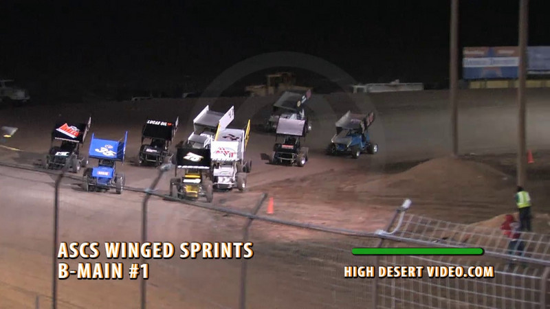 Southern New Mexico Speedway - Las Cruces, NM 11/13/2010. Joshua Hodges, #74 and Matt Covington, #95 get together at the start of the first B-Main, causing the #74 car to flip end-over-end.