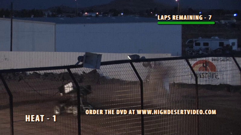 Fuentes Flips Out! - Cesar Fuentes, driving the #27 Renegade Sprint Car, jumps the right rear of the #11 car and cartwheels over the fence and into the street bordering El Paso Speedway Park, coming to rest upside down across the street. Cesar was not injured in this incident.