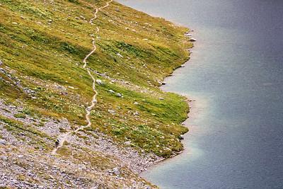 Descending along Lai da Ravais-ch, Swiss alps