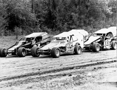 Jimmy Horton John Hewitt lead Dave Lape, and Charlie Rudoulph down the back stretch at Rolling Wheels. 1985