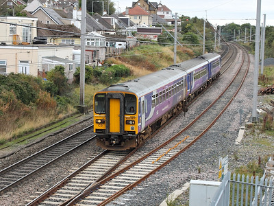 153317 leads a class 156 past Hest Bank on the 4th October 2013